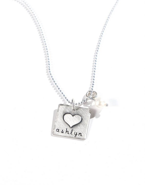 Sterling silver square with a heart fused on top with hand stamped name. Perfect personalized necklace for someone close to heart
