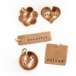 Add a beautiful copper charm to your existing necklace. Each piece is hand stamped with a name of your choice