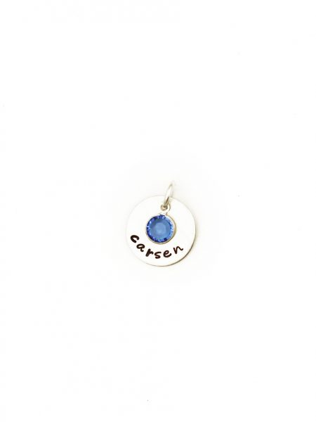 A dainty sterling silver disc with name engraved on it. Add your birthstone in the middle of the disc