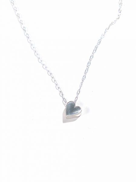 Sterling silver heart hung on a beautiful sterling silver dainty chain. Perfect way to show love to that special person