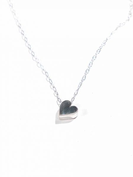 Sterling silver heart hung on a beautiful sterling silver dainty chain. Simple yet classy necklace for your loved ones.
