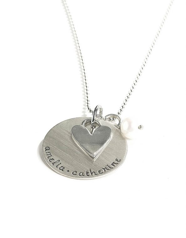 Hand stamped sterling silver disc along with a heart charm and a freshwater pearl. Perfect gift for mom, grandma