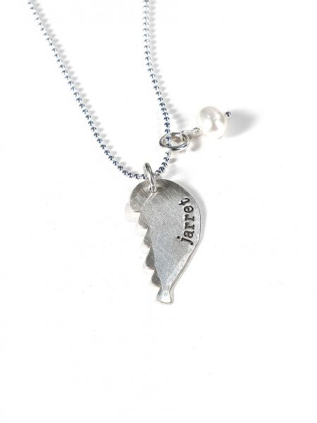 Hand stamped sterling silver angel wing makes for a sentimental remembrance necklace. Perfect gift for mom, grandma