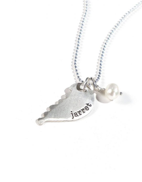 Sterling silver angel wing hand stamped with name. Perfect personalized gift for mom, grandma