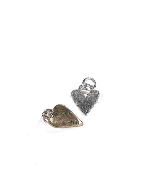 A handmade heart charm available in sterling silver and bronze, is a beautiful addition to your necklace. Perfect gift for wife, mom