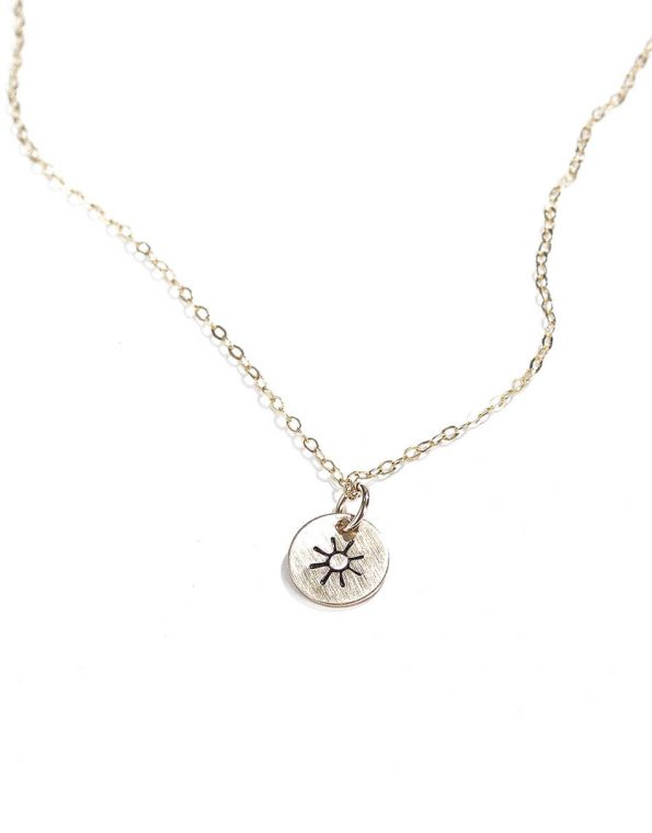A dainty disc available in sterling silver and gold. A reminder to stay happy. Perfect for spouse, daughter, niece