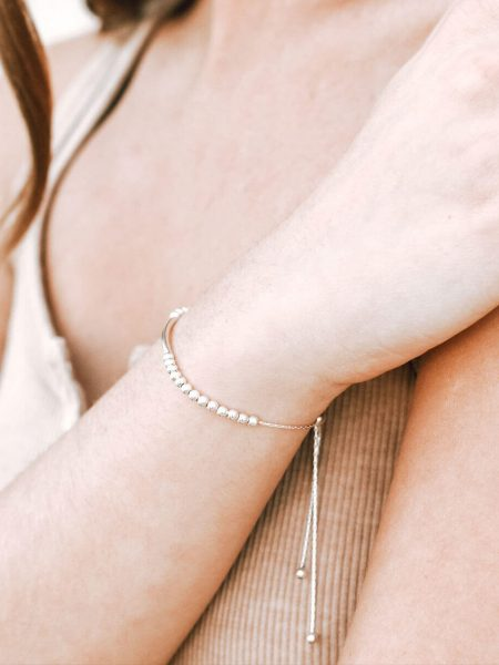 A beautiful sterling silver beads bracelet , adjustable from size 5 to 9. Perfect gift for friends.