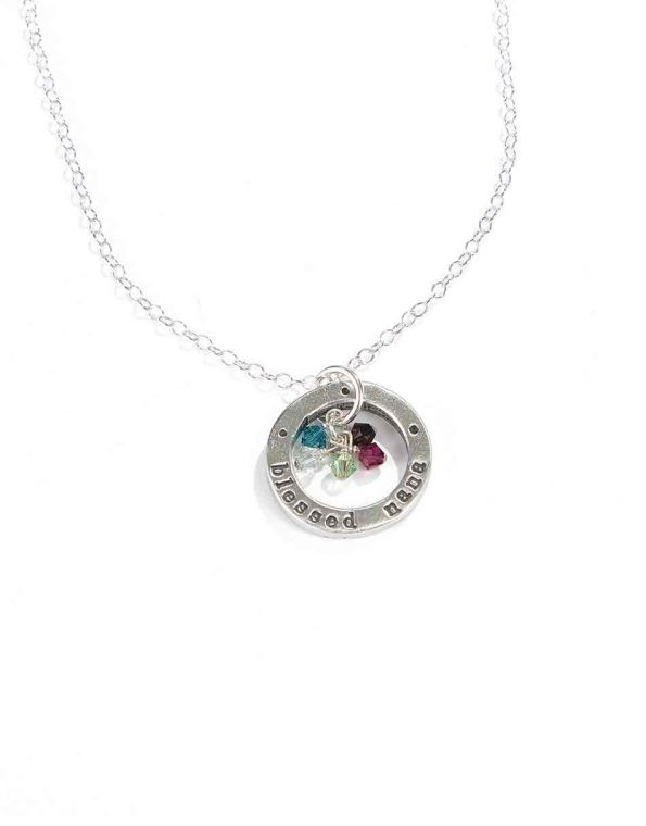 """A sterling silver circle hand stamped with """"blessed nana"""" along with grand kids birthstones. Perfect gift for a grandma"""