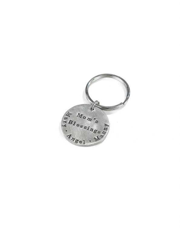 Handsculpted circle charm, hand cast in fine pewter and hung on a silver keyring. Makes a fun gift for a dad, grandparents