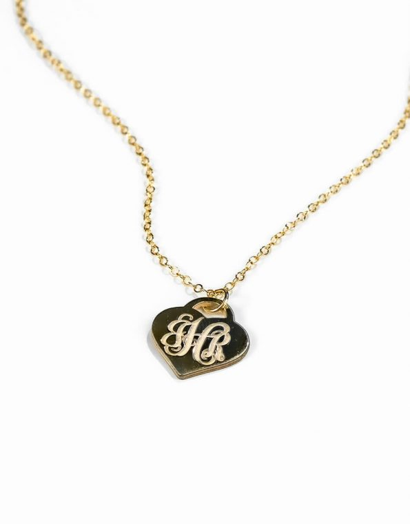 "A beautiful ""Tiffany"" style gold plated heart monogramed with initials. Perfect personalized gift for wife, mom or grandma"