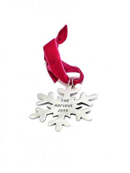 Classic snowflake ornament is a sweet sentiment for Christmas. Made in fine pewter, hung on a velvet ribbon, along with a freshwater pearl