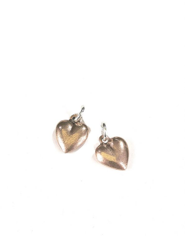 A beautiful heart charm made in copper makes for a perfect gift for mom, new mom, wife