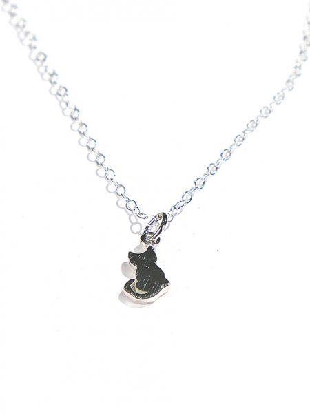 A cat made in sterling silver, hung on a sterling silver dainty chain. Perfect gift for a cat lover or for yourself.