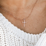 A small hand forged cross charm created with sterling silver, hung on a sterling chain. Perfect for girls of all ages.