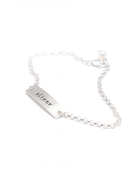 A sterling silver rectangle charm bracelet with name engraved on it. Great gift for daughter, sister, mom, spouse