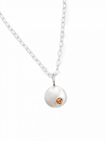Sterling silver dainty disc necklace embedded with a beautiful birthstone crystal. Perfect gift for mom, wife, sister