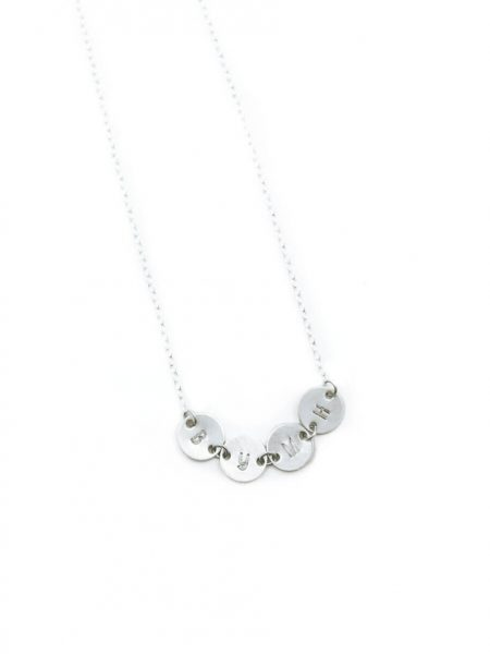 A dainty connected initial disc necklace in sterling silver. Sweetest way to connect with all of your loved ones together.