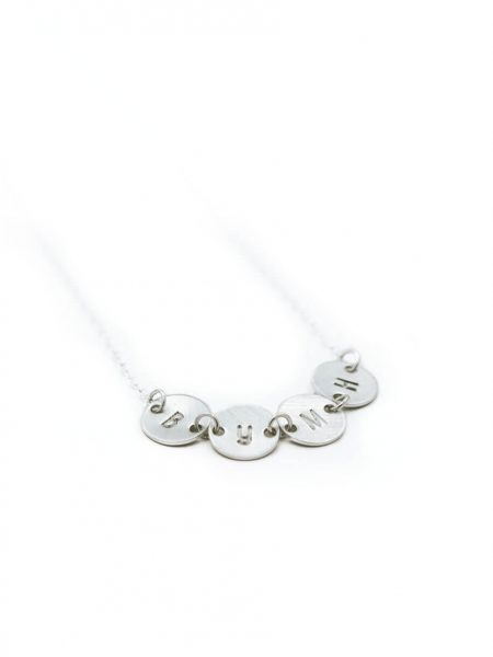 Dainty connected initial disc necklace in sterling silver. A sweet way to connect all of your loved ones together.