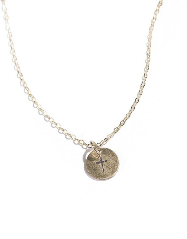 A beautiful gold-filled disc hand-stamped with a cross and hung on a pretty dainty chain. The perfect necklace for your wife, daughter, mom.