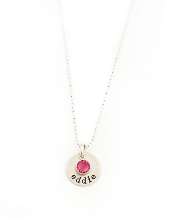 Sterling Silver Necklace with circle charm and name engraved. It has a birthstone attached.