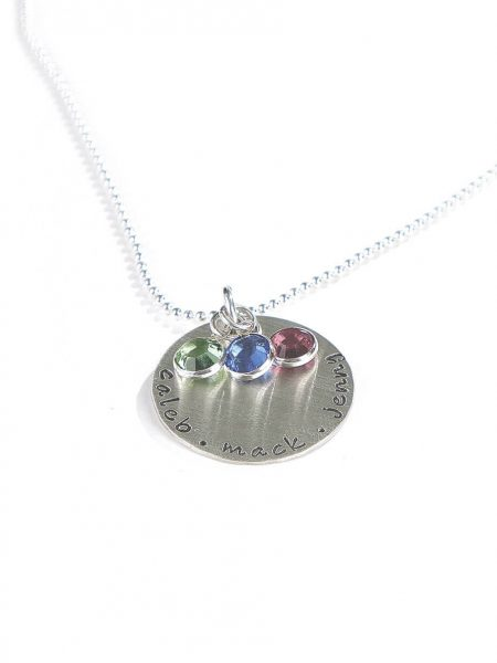 Sterling siver disc with handstamped names along with a birthstone crsytal. Perfect gift for wife, mom