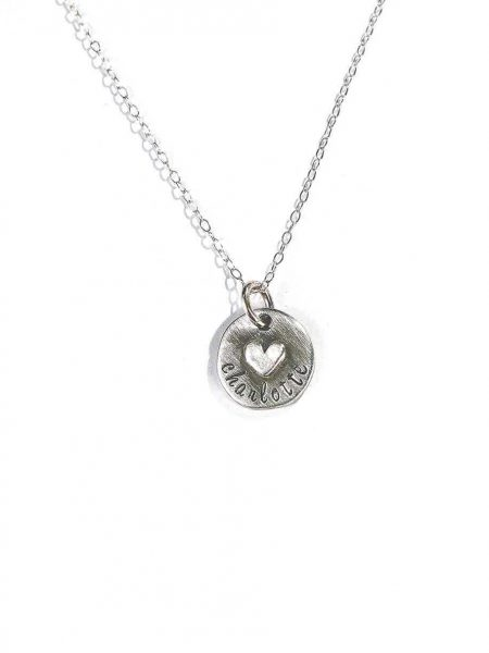 A beautiful sterling silver disc with a sterling silver heart soldered on it. Hand-stamped with your choice of name. Best gift for mom, or wife