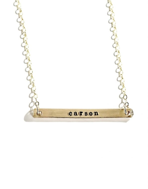 Sterling silver or gold-filled dainty bar with hand-stamped name hung on a dainty chain. Perfect gift for moms