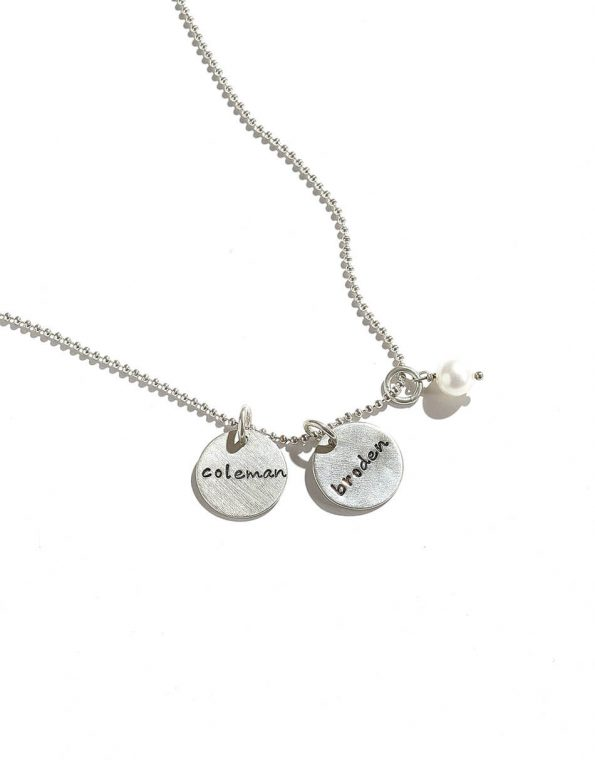 Dainty sterling silver disc with hand stamped names. Personalize the necklace by adding more charms