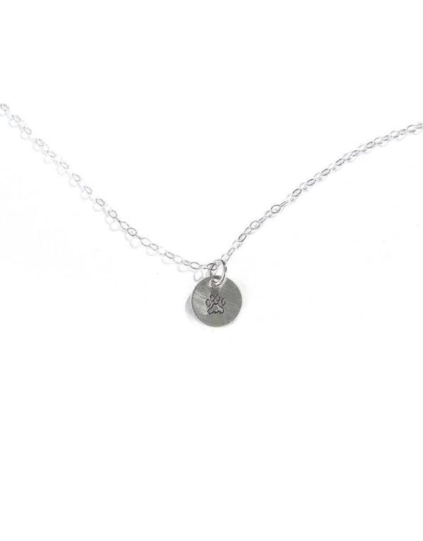 A beautiful sterling silver disc hand-stamped with the cutest little paw makes a great gift for a crazy dog lover.