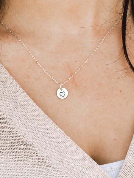 A sterling silver or gold filled 3/8″ disc with a heart hand-stamped on it