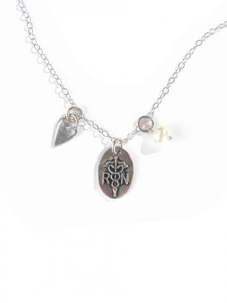 Handmade charms created in fine pewter and hung on your choice of chain with a freshwater pearl for a hardworking nurse