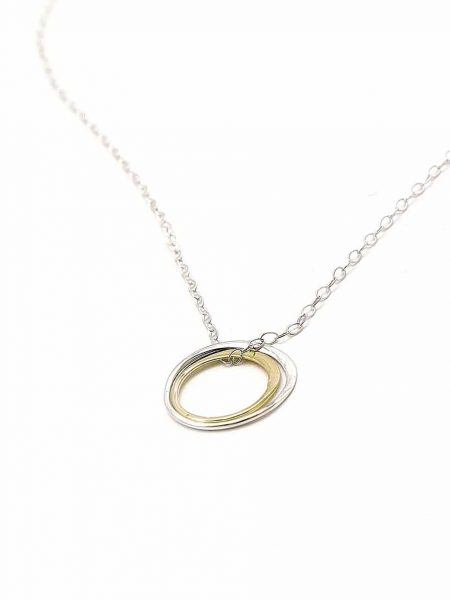Made with a sterling silver circle and a gold filled circle, hung on a gorgeous sterling silver dainty chain. Best gift for soul sisters.