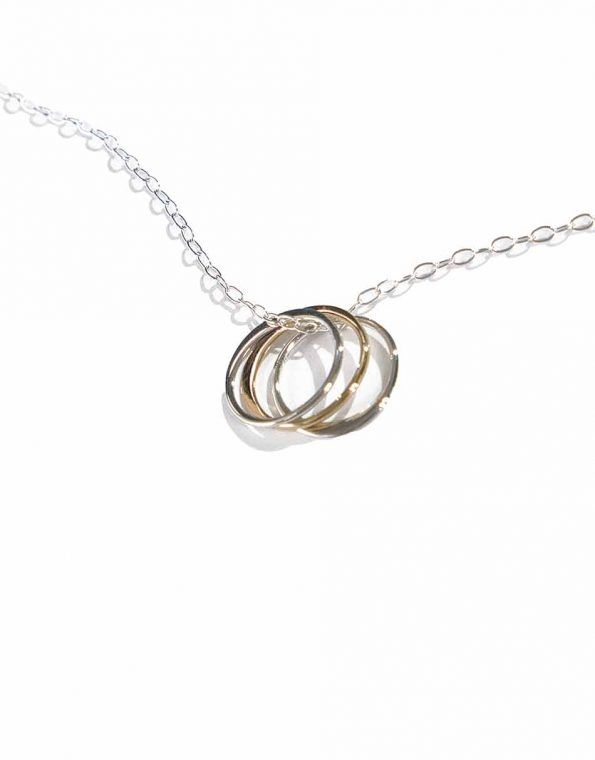 2 sterling silver circles and 1 gold-filled circle, hung on a sterling silver dainty chain. This necklace is symbolic as well as stunning