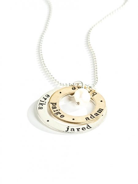 A sterling silver circle and a gold-filled circle, both with hand stamped names or dates. Personalized necklace gift option for wife, mom, grandma