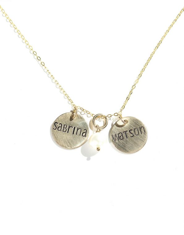 Gold-filled dainty disc with hand stamped name and a freshwater pearl. Perfect gift for wife