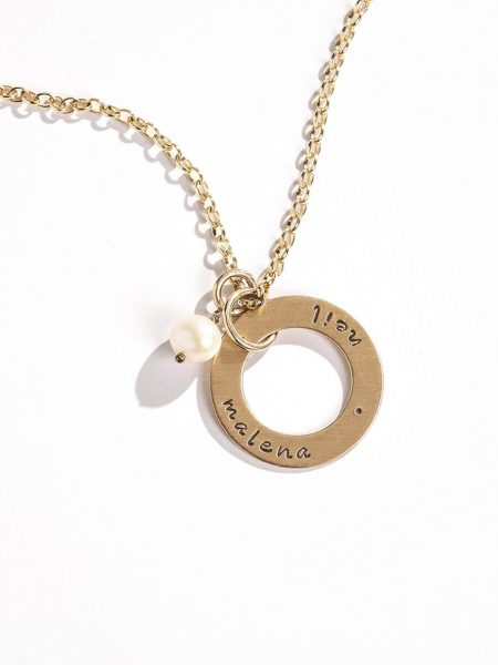 A gold-filled circle with hand stamped names or dates. Perfect gift for wife, mom