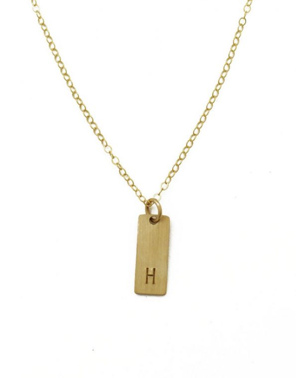 A beautiful dainty golden tag necklace with the perfect size to capture initials or a design stamp. Best gift for mom, new mom, grandma