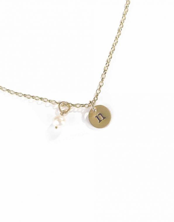 A dainty gold-filled disc with hand stamped initials. Personalized necklace to gift to wife, sister, daughter