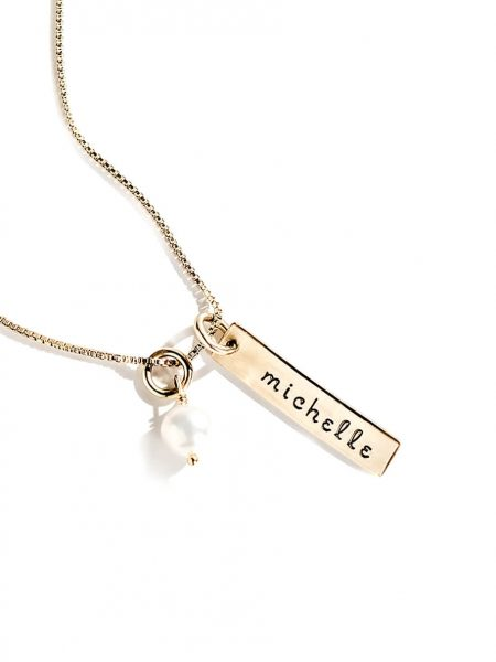 A beautiful gold-filled charm hand stamped with name. Hung on a gold-filled chain with a freshwater pearl.