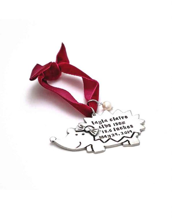 Made in fine pewter, up to 4 lines of text, hung on a velvet ribbon, and topped off with a freshwater pearl. Perfect Christmas gift for kids