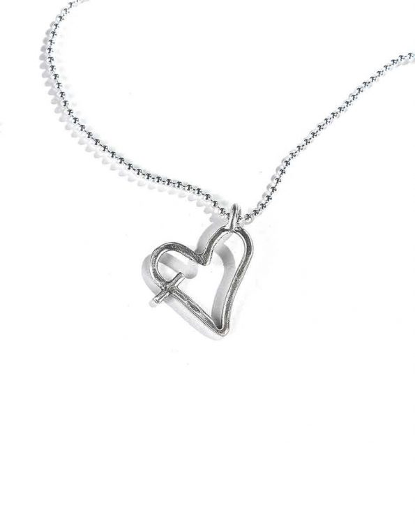 An imperfect heart, hand forged in beautiful sterling silver and hung on a sterling silver chain Perfect necklace for a friend, sister, colleague.