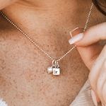 A dainty sterling silver square engraved on 4 sides with your initials. Perfect gift for family, kids, or even a couple