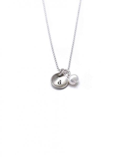 Sterling silver charms hand stamped with initial. Add additional pearls or birthstones to it. Perfect gift for wife, mom, sister, daughter