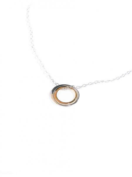 A beautiful sterling silver circle hung beside a gold-filled circle, on a sterling dainty chain. Perfect jewelry for a mother or a daughter