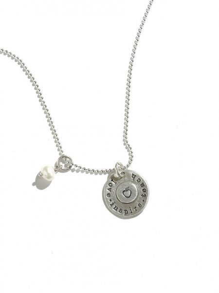 "Sterling silver disc with ""Love.Inspire.Teach"" message and an apple in the center. Perfect gift for your teacher."