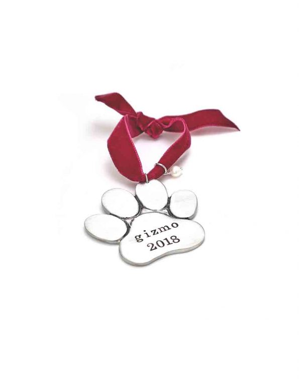 Perfect for your precious furry family. Hand-stamped with your pup's name and hung on a festive red velvet ribbon and topped off with a freshwater pearl.