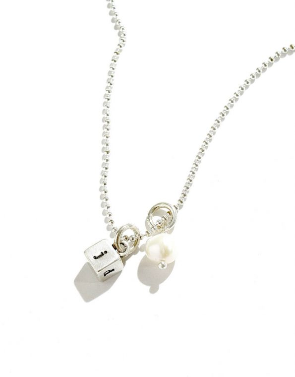 A dainty sterling silver square hand stamped on 4 sides with initials. Perfect gift for mom, wife