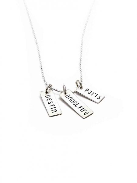 A sterling silver rectangle hand-stamped with date, name or time and hung on a gold dainty chain or sterling ball chain. Perfect gift for wife or mom
