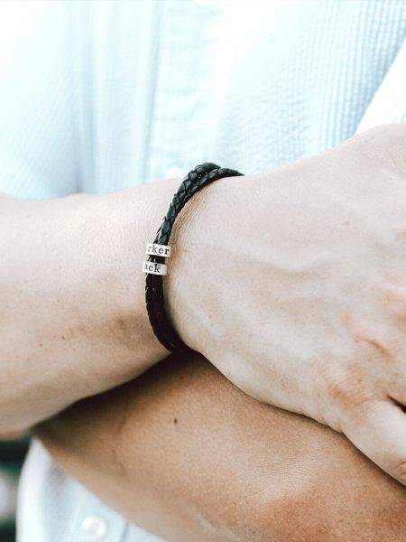 Black leather braided bracelet wrapped with sterling silver custom made rings hand-stamped with text