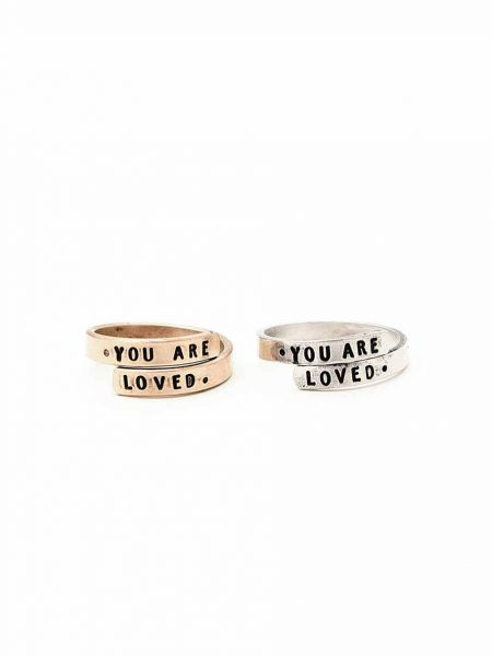 A ring that wraps and is handstamped on the ends with a message. Available in sterling silver and gold-filled. Best personalized ring for wife